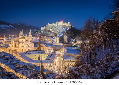 Beautiful classic view of the historic city of Salzburg with famous Festung Hohensalzburg in scenic post sunset twilight during magic blue hour at dusk in winter, Salzburger Land, Austria