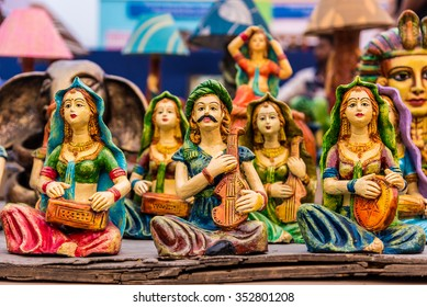 Beautiful clay dolls of miniature folk musicians performing in a band of classical Indian music