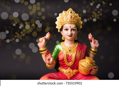 Beautiful Clay Idol of Hindu Goddess Lakshmi OR Laxmi, selective focus