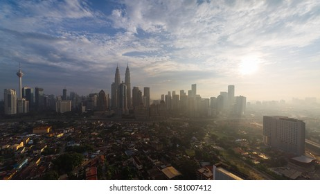 Beautiful and clear aerial sunrise view of Kuala Lumpur city skyline and Kampung Baru, an old village in the city