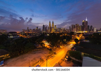 Beautiful and clear twilight view of Kuala Lumpur city skyline from Kampung Baru, an old village in the city.