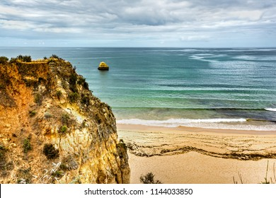 Beautiful cliffs above Praia dos Tres Castelos to the west of Praia da Rocha in south Portugal. Portimao, Algarve region.