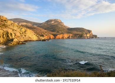 Beautiful cliffs on Agali beach on Folagandros island during sunset. Cyclades, Greece