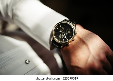Beautiful clock on the hand of young man.