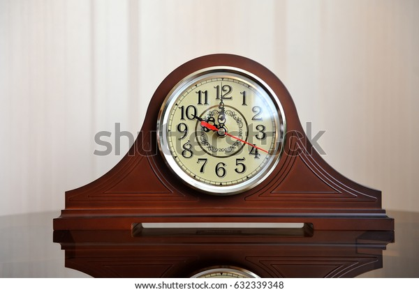 Beautiful clock in retro style on a glass table