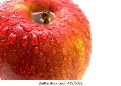 Beautiful close up red apple with drops.
