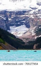 Beautiful close up view of Lake Louise in Banff National Park in the Rocky Mountains, Alberta, Canada. With canoes in the foreground.