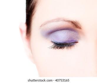 Beautiful closed painted colorful female eye closeup