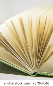 A beautiful closeup of a blank notebook in green covers.  Shallow depth of field photo.
