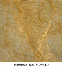 Beautiful closeup gold marble fragment with detailed golden veins texture