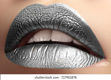 Beautiful Closeup Lips with frost silver color Makeup. Fashion Celebrate Make-up for New Year. Shiny Christmas Glitter Lip style. Metalic makeup