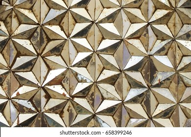Beautiful closeup stained pattern mirror art in hexagon star pattern.