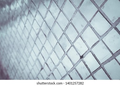 Beautiful closeup textures abstract tiles and silver and white color glass wall background and pattern