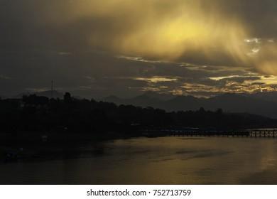 Beautiful cloud of fog reflection during sunrise on the wooden bridge (Mon bridge)backgroud. Soft Focus, Motion Blur Due to Long Exposure Shot.