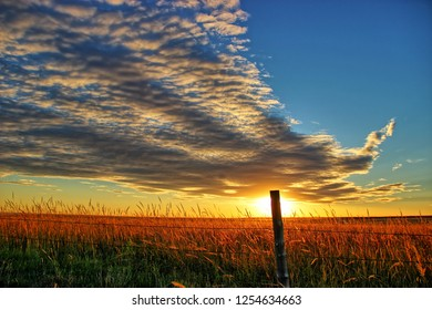 Beautiful Cloud Formation over a Prairie Field in the Sunset Hour in Western Kansas