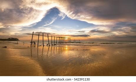 Beautiful cloud with golden sunset on the beach, so amazing sky at Nai Han beach, Phuket