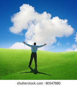 Beautiful cloud and happy young man with his hands up.Shallow DOF