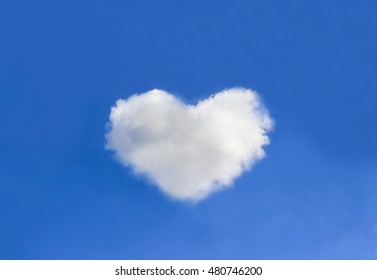 Beautiful cloud with heart shapes on blue sky background