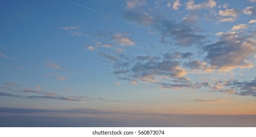 Beautiful clouds against a blue sky at sunset.