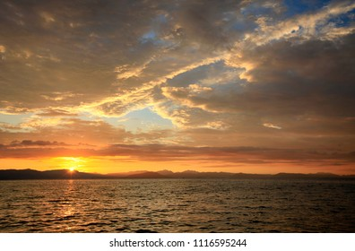Beautiful clouds at dawn in the sky over the sea off the coast of the island of Corfu in Greece