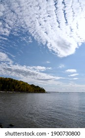 beautiful clouds fill the blue sky over the east shore of lake Winnipeg near Belair  Manitoba