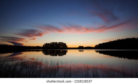 Beautiful clouds and lake landscape after sunset finland