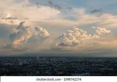 Beautiful clouds in the sky above the city at sunset.