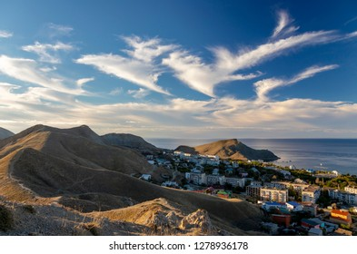Beautiful clouds in the sky over the resort village in Crimea