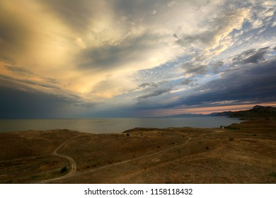 Beautiful clouds in the sky at sunset on the Crimean coast