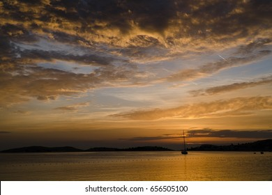Beautiful Clouds at Sunset with A Sailboat