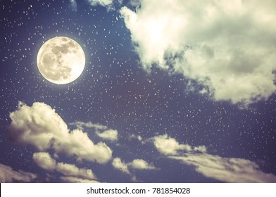 Beautiful cloudscape with many stars. Night sky with bright full moon and cloudy, serenity blue nature background. Outdoor at nighttime with moonlight. Vintage tone. The moon taken with my own camera.