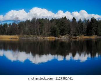 Beautiful cloudscape over forest at waterfront