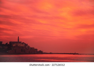 Beautiful cloudscape over the sea after sunset and view on Old Jaffa (Jaffa, Tel-Aviv, Israel). Toned photo.