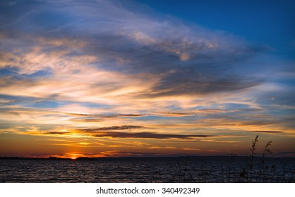 Beautiful cloudscape with sunset on a coast river