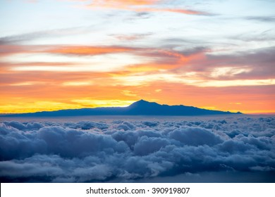 Beautiful cloudscape with Tenerife island on background on the sunrise in Spain - Shutterstock ID 390919807