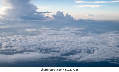 The beautiful cloudy and blue sky at early in the evening (view from airplane).