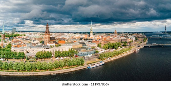 """Beautiful cloudy day over Riga. People gathering to celebrate Midsummer by the river Daugava. Aerial view from above. Celebrating """"Jani"""" and """"Ligo""""."""