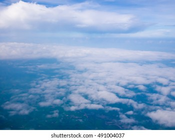 Beautiful cloudy sky abstract background concept related idea. View from airplane window
