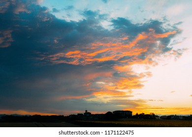 Beautiful cloudy sky with sun rays. Cloudy abstract background. Sunset light