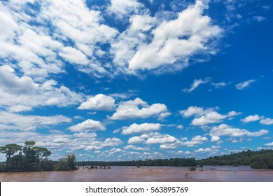 Beautiful cloudy sky under Iguazu river, Argentina.