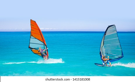 Beautiful cloudy sky with Windsurfer Surfing The Wind On Waves In Alacati - Cesme, Turkey