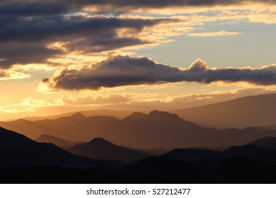 Beautiful cloudy sunset over the mountains