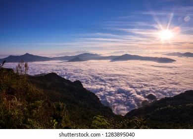 Beautiful clounds and fog coverage multiple mountains valley at sunrise in the morning at Phu chi Duen, Chiang Rai Province, Thailand