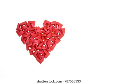 Beautiful cluster of small red paper hearts come together to form a large heart of love isolated on a white background with clipping path.