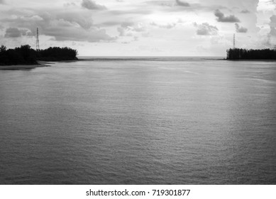 Beautiful coast, beach have electric pole connect with sea and cloud sky(black and white), before sunset at Phuket, Thailand.