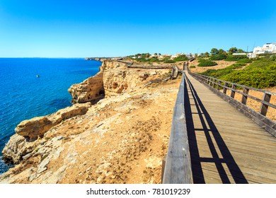 Beautiful coast with wooden path in Carvoeiro, Algarve, Portugal