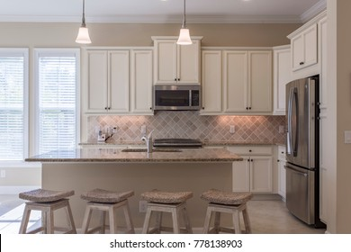 A Beautiful Coastal Kitchen with a very Neutral Color Scheme