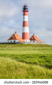 Beautiful coastal landscape with traditional lighthouse at North Sea in Nordfriesland, Schleswig-Holstein, Germany