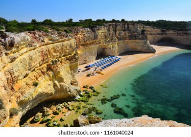 Beautiful coastline with cliffs and sandy beach in Algarve, Portugal