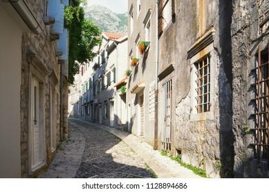 Beautiful cobblestone street. Montenegro, town of Risan, Gabela street